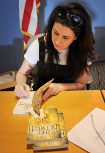 Author Marina Cohen signs some books before the ceremony. (photo by Rodney Curtis/School Life Troy)